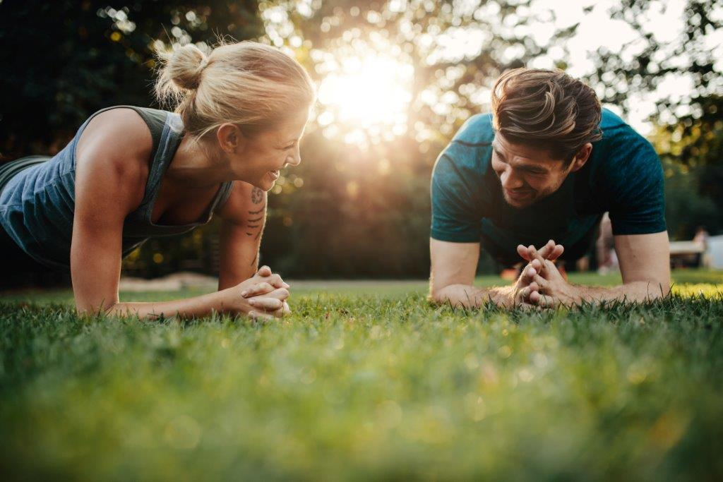 Canva - Fit Young Man and Woman Exercising in Park.jpeg